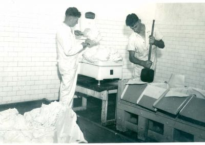 Noel Prior (left) and Brian Walsh packing butter, ICCD c.1950. Donated by Ray Carmody.